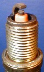 Свеча Ваз 2109 золотистого цвета